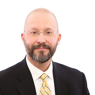 Portrait photo of Mark Carlton, a partner and attorney at Harman Claytor Corrigan Wellman Litigation Firm