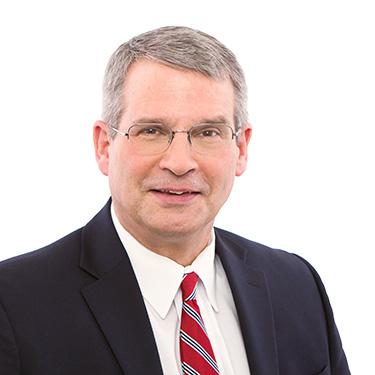 Portrait photo of David Corrigan, a partner and attorney at Harman Claytor Corrigan Wellman Litigation Firm