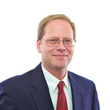 Portrait photo of Thomas Garrett, a partner and attorney at Harman Claytor Corrigan Wellman Litigation Firm