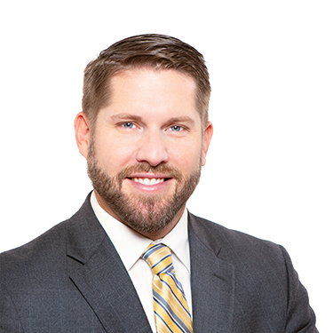 Portrait photo of Jon Nichols, an attorney and partner at Harman Claytor Corrigan Wellman Litigation Firm