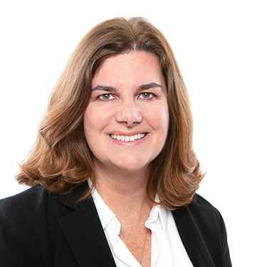 Portrait photo of Juliane Miller, a partner and attorney at Harman Claytor Corrigan Wellman Litigation Firm