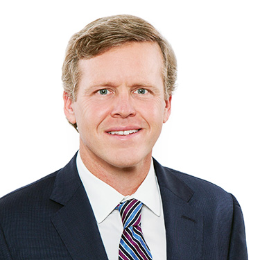 Portrait photo of John Peterson, a partner and attorney at Harman Claytor Corrigan Wellman Litigation Firm